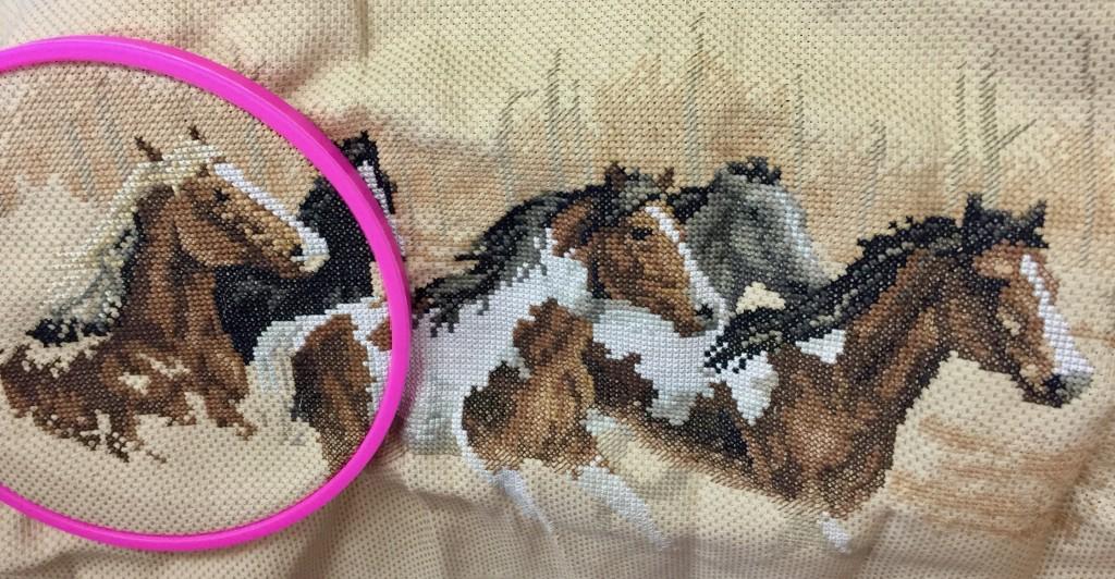 Cross-stitched horses.