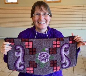 Linda showing off her very first hooked piece! Congrats on such beautiful work!